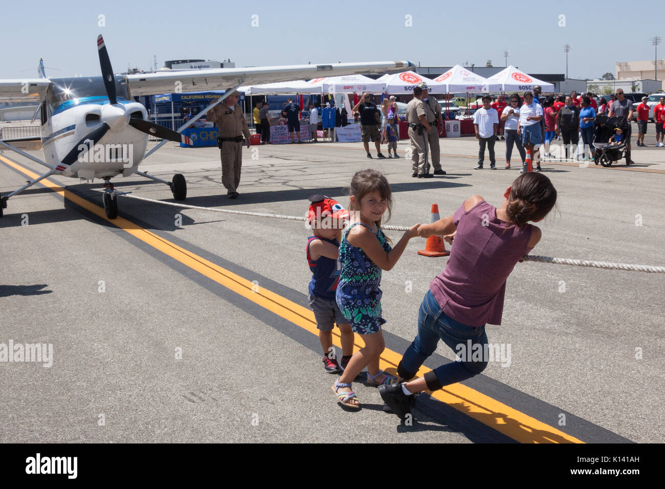 August 19, 2017 - Children have a plane pull of their own at the Special Olympics Southern California Plane Pull at the Long Beach Airport in Long Bea - Stock Image