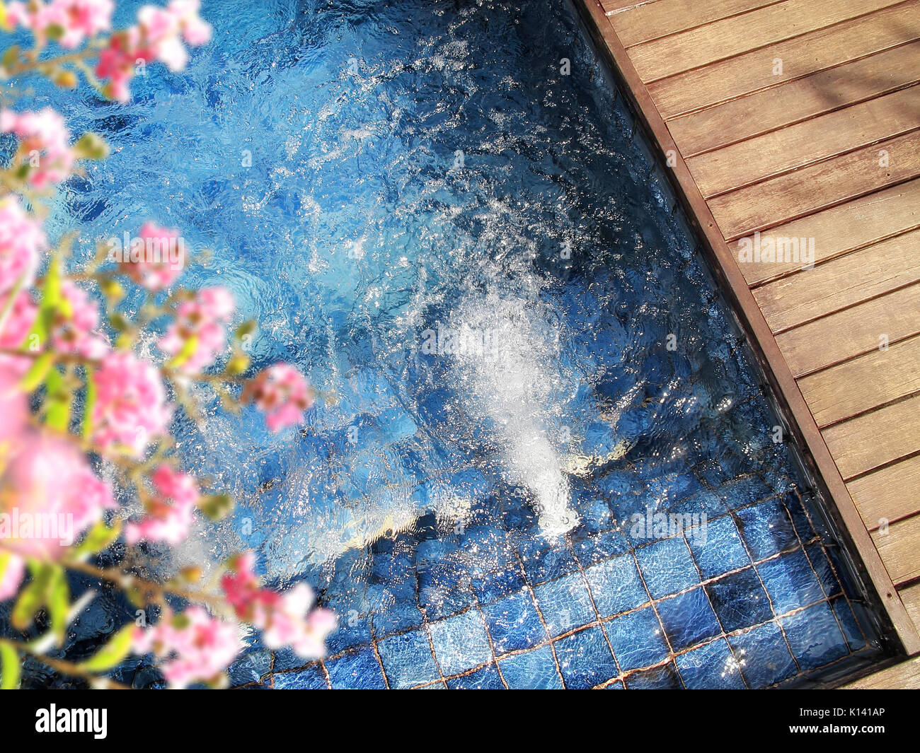 close up outdoor jacuzzi with clear clean water - Stock Image