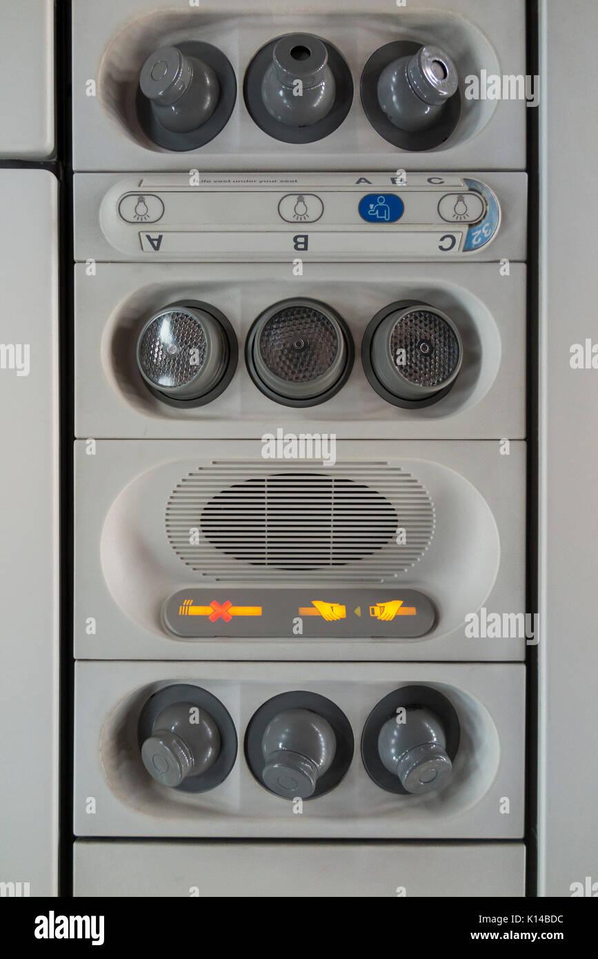 Passenger No Smoking Fasten Seat belt sign & cool air nozzles / nozzle array / vents. Airbus A320 aircraft / air Stock Photo