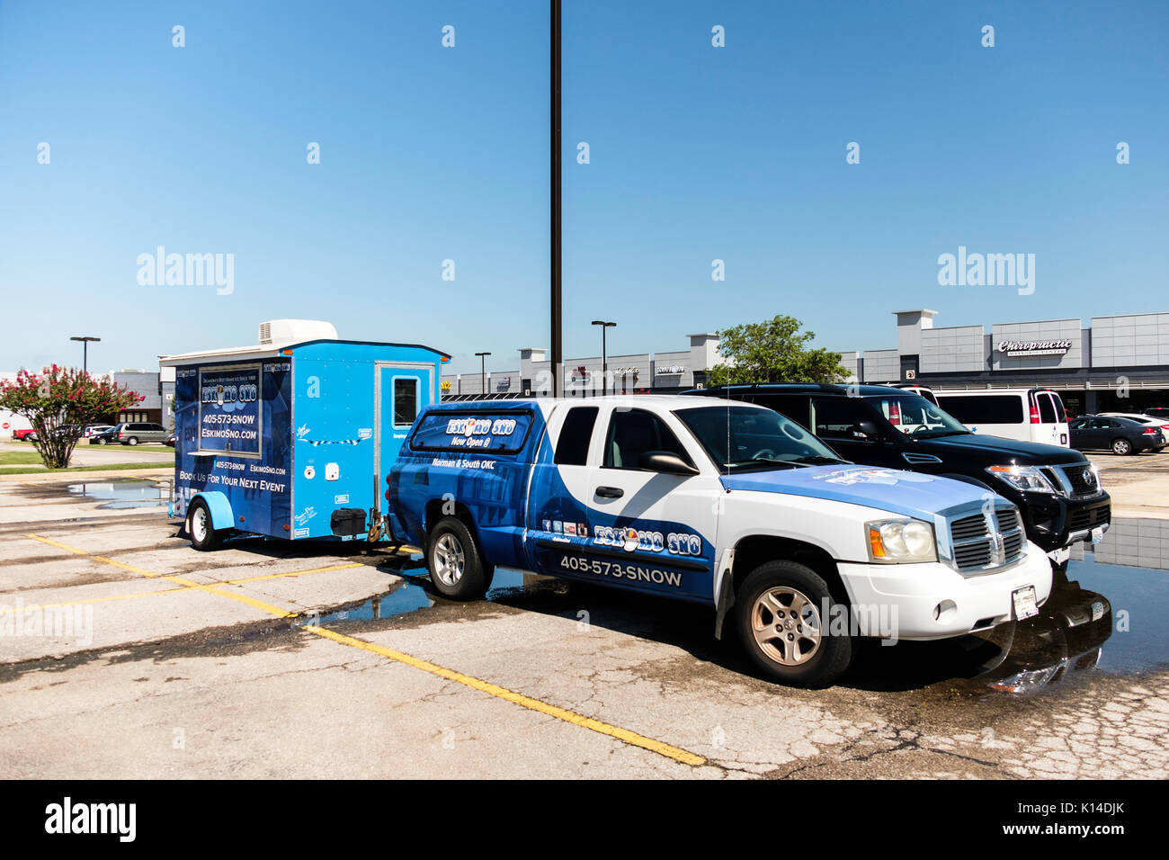 A Sno Cone trailer  hitched to an automobile, advertising Sno Cones,called EskimoSno. Parked in a parking lot in Norman, Oklahoma, USA. - Stock Image