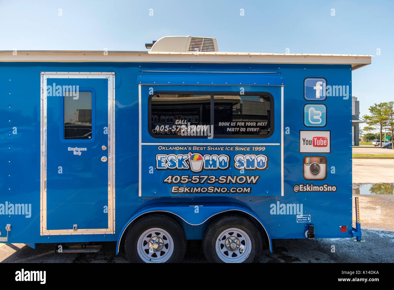 A Sno Cone trailer advertising Sno Cones,called EskimoSno. Parked in a parking lot in Norman, Oklahoma, USA. - Stock Image
