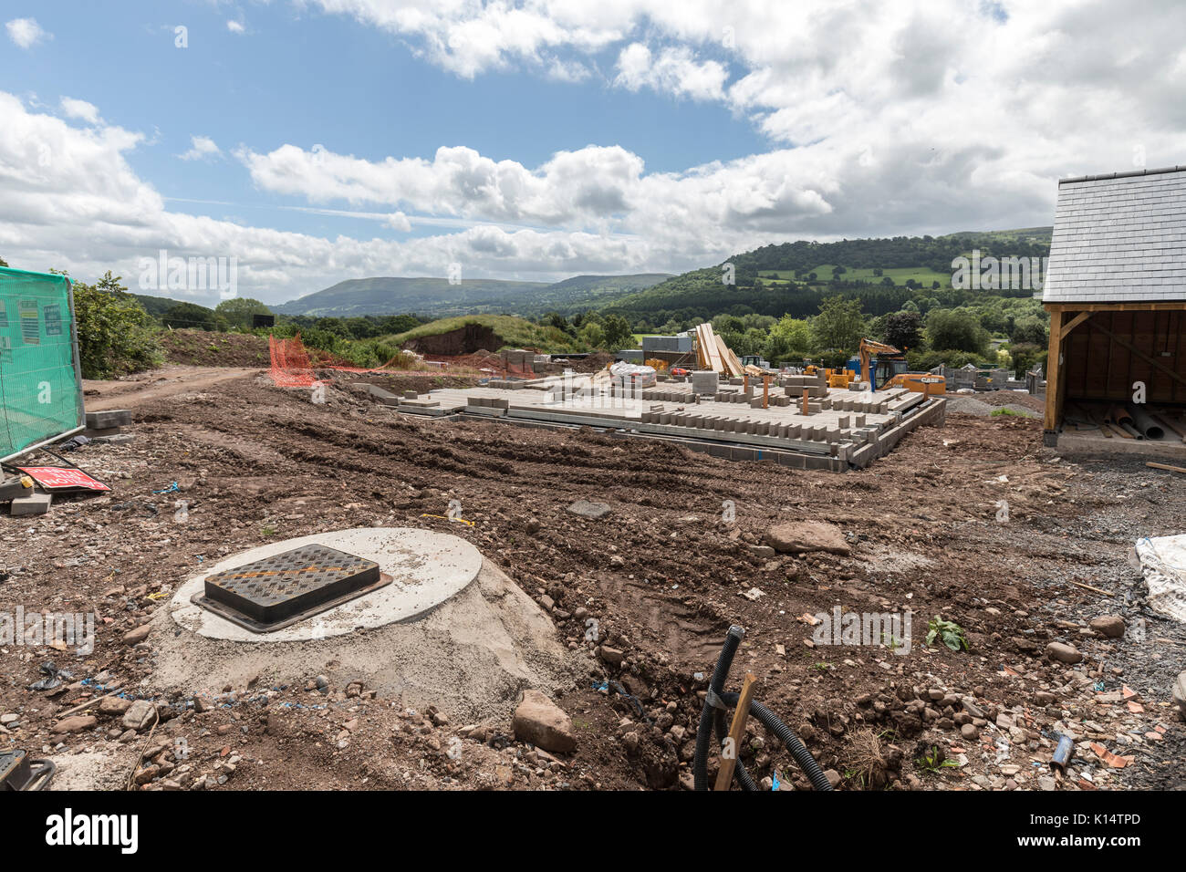 Building site with drainage cover for newbuild houses, Crickhowell, Wales, UK - Stock Image