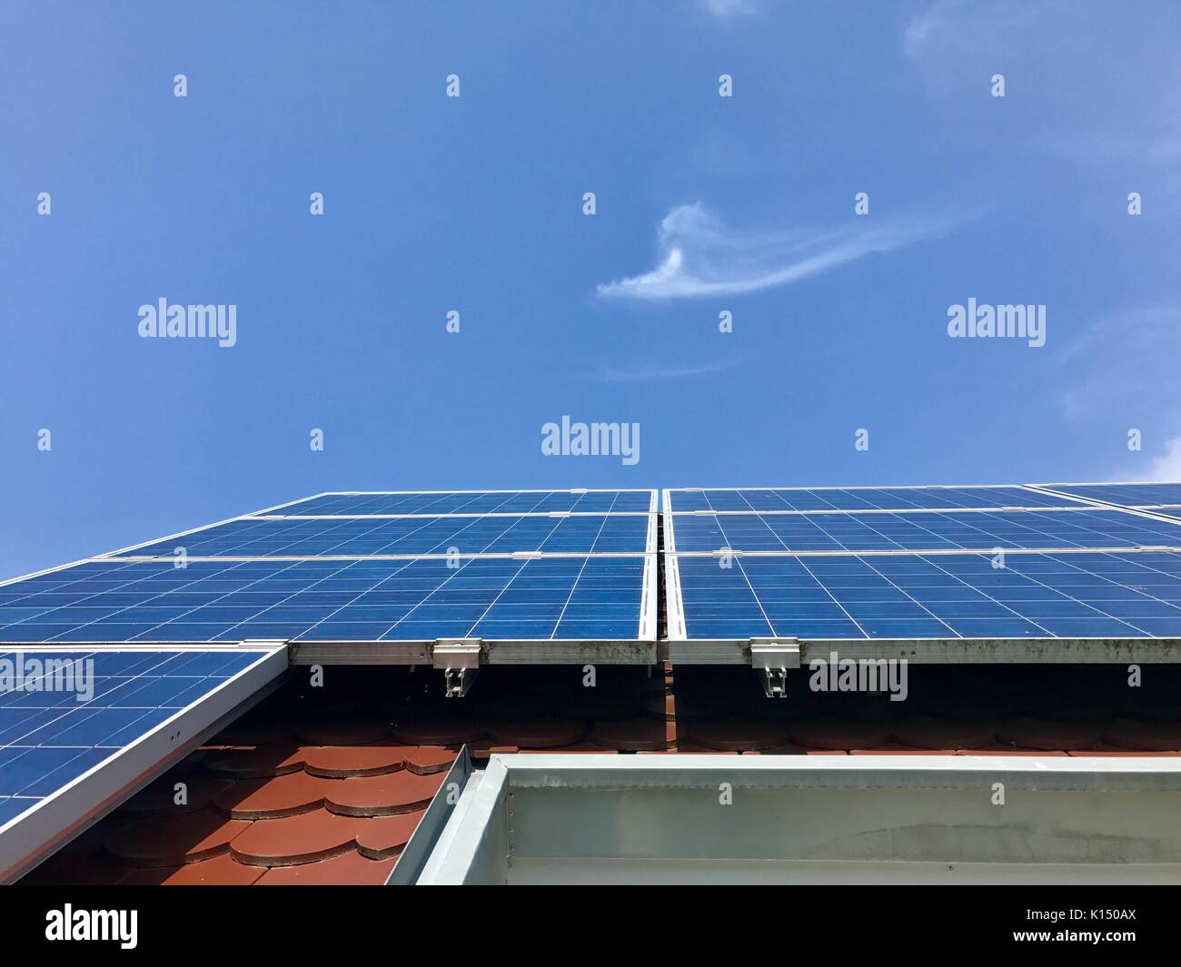 House roof with solar panels on top - Stock Image