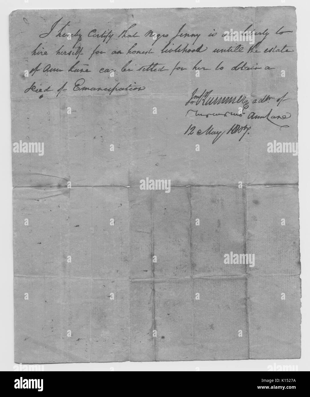 A letter that states that a slave named Jenny is allowed to find herself work, she is to work until the estate of her owner is settled at which point she can obtain a deed of emancipation, 1807. From the New York Public Library. - Stock Image