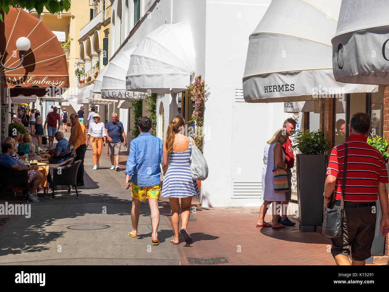 visitors and tourists admire the designer boutiques on the island of capri, italy - Stock Image