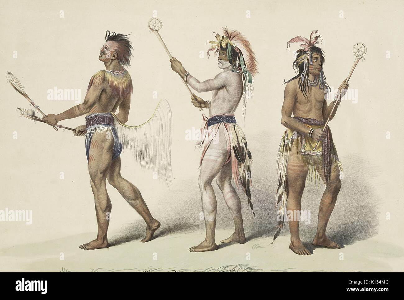 Native Americans holding primitive lacrosse sticks and preparing to