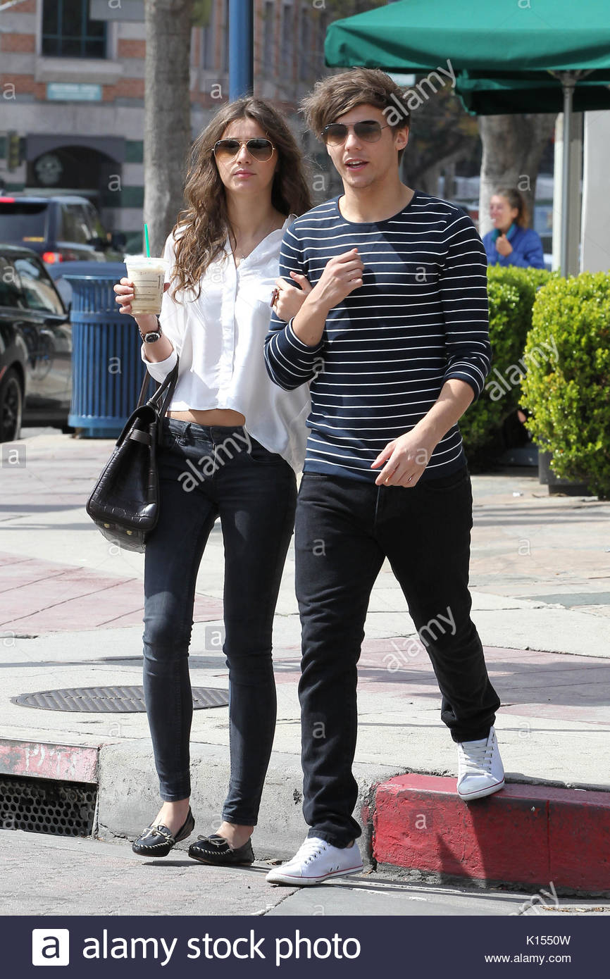 Louis Tomlinson and Eleanor Calder. One Direction band ... | 866 x 1390 jpeg 195kB