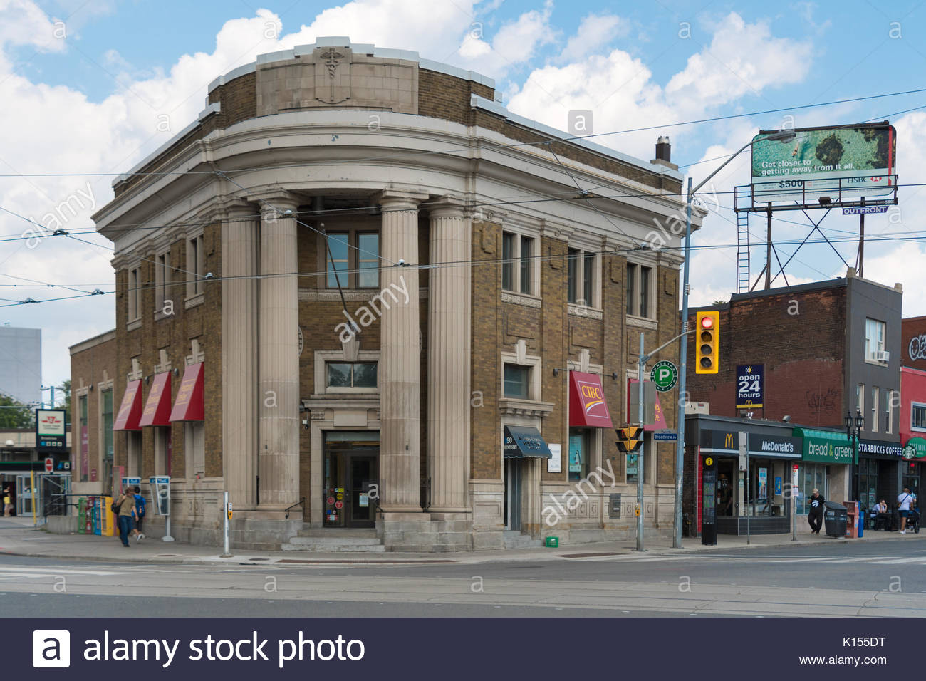 CIBC branch in old vintage building at Danforth and Broadview Avenues. The image has the traditional streetcars wires and depict the everyday lifestyl - Stock Image