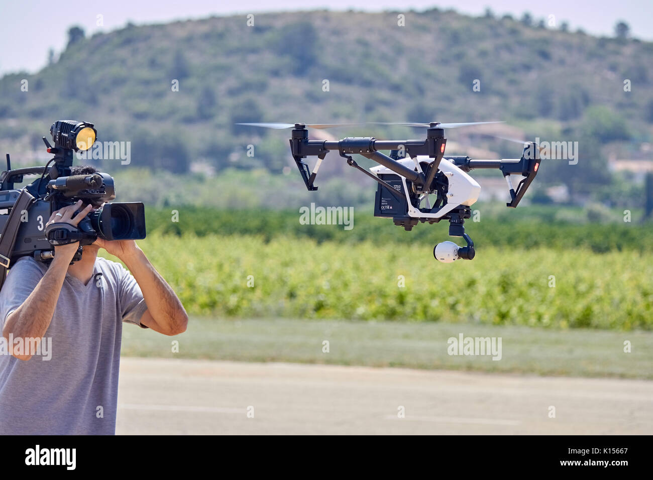 Cameraman filming drone in flght Stock Photo