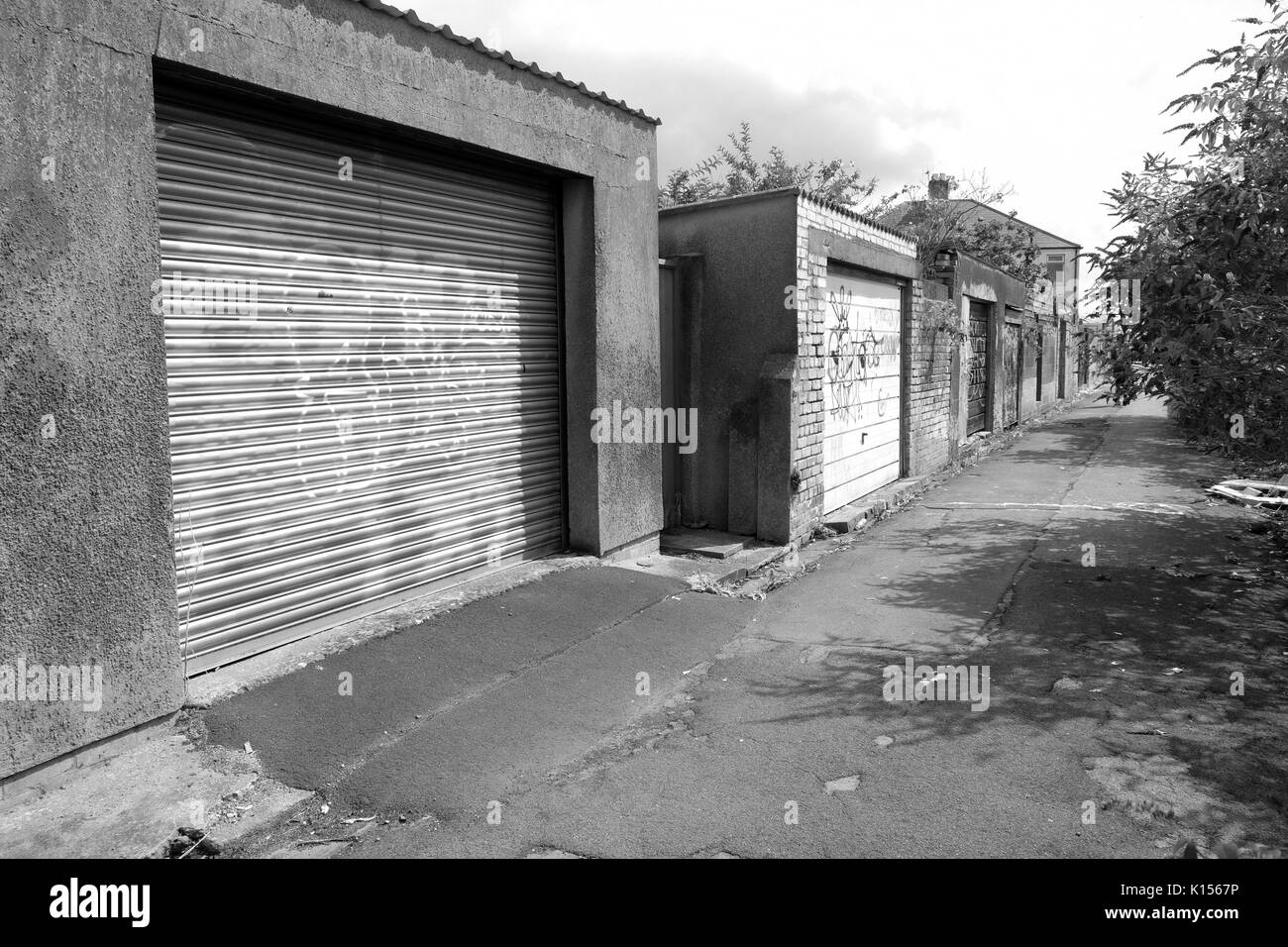 Garage doors in a back alley in central Cardiff, South Wales. - Stock Image
