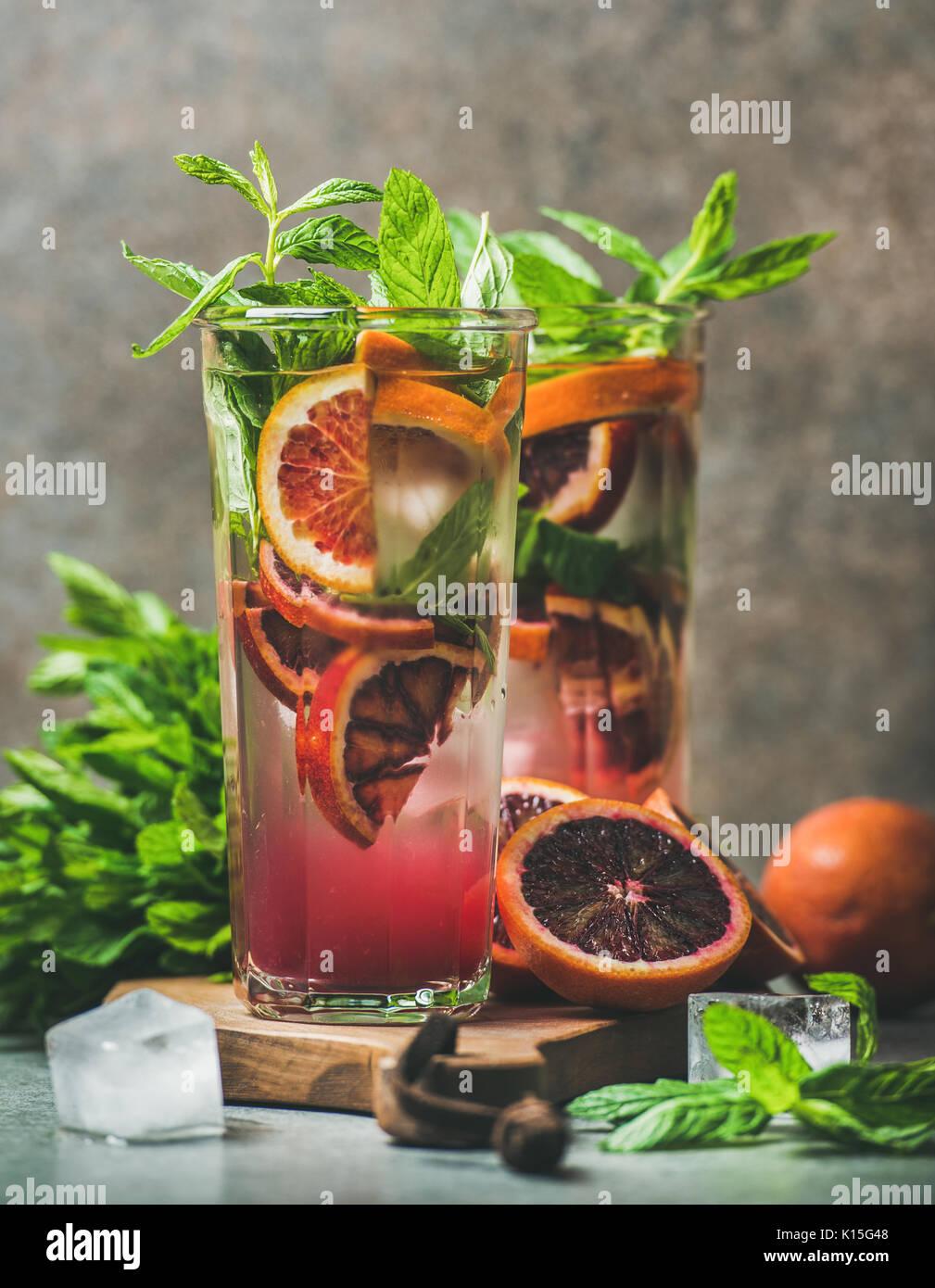 Blood orange citrus lemonade with mint and ice - Stock Image