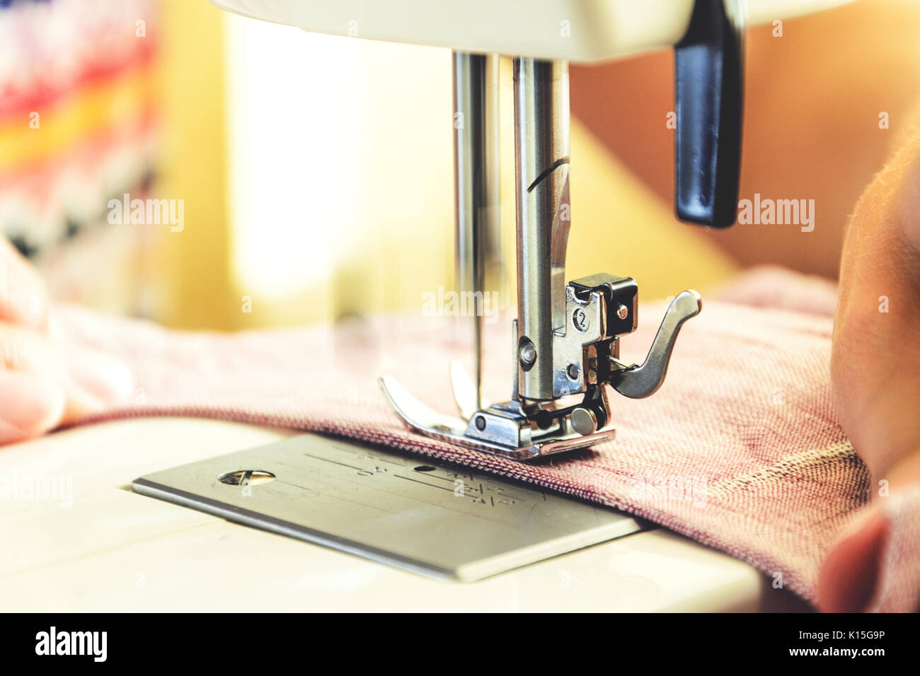 Sewing process on the sewing machine - Stock Image
