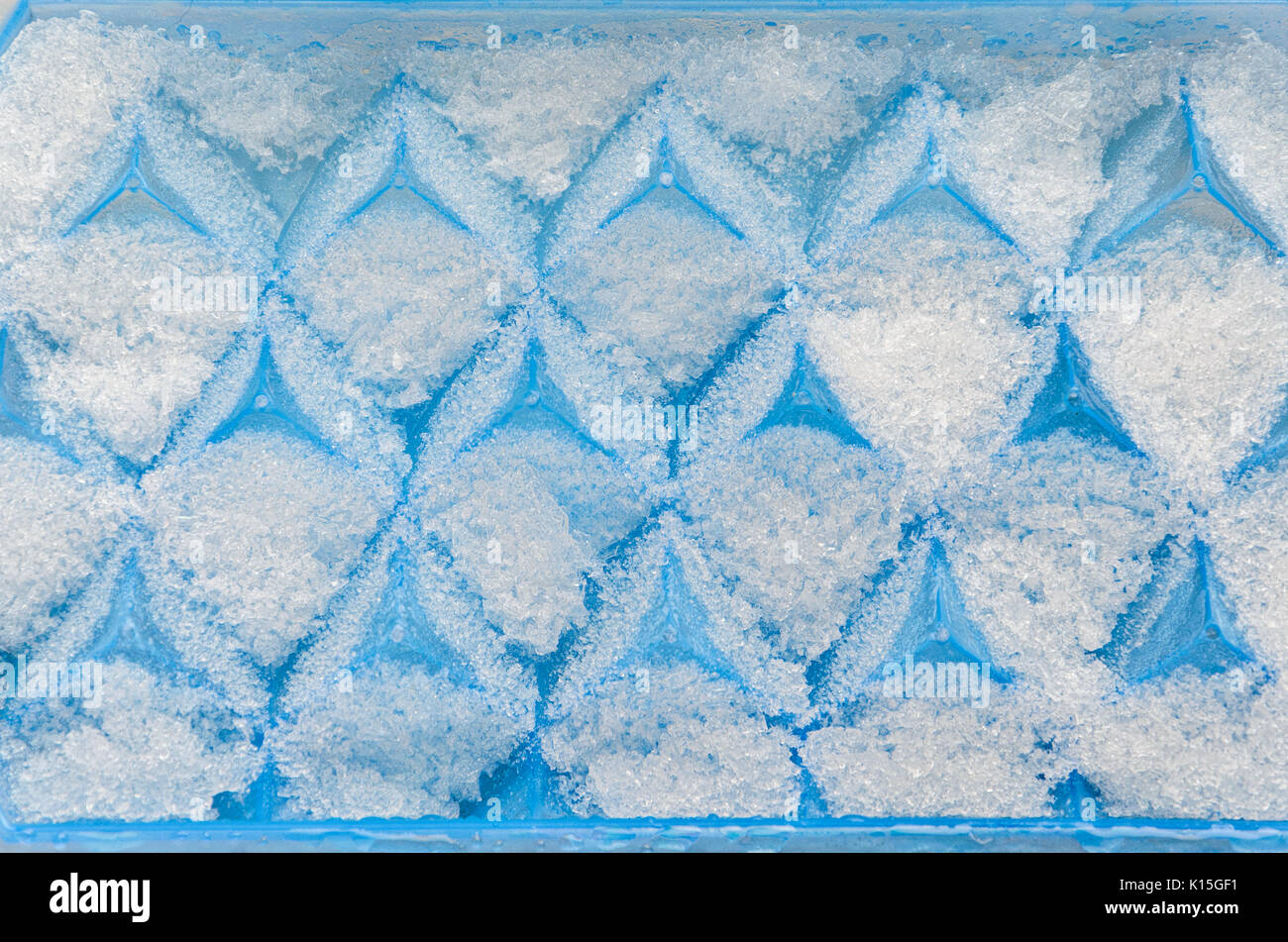 Blue tray for making ice cubes. - Stock Image
