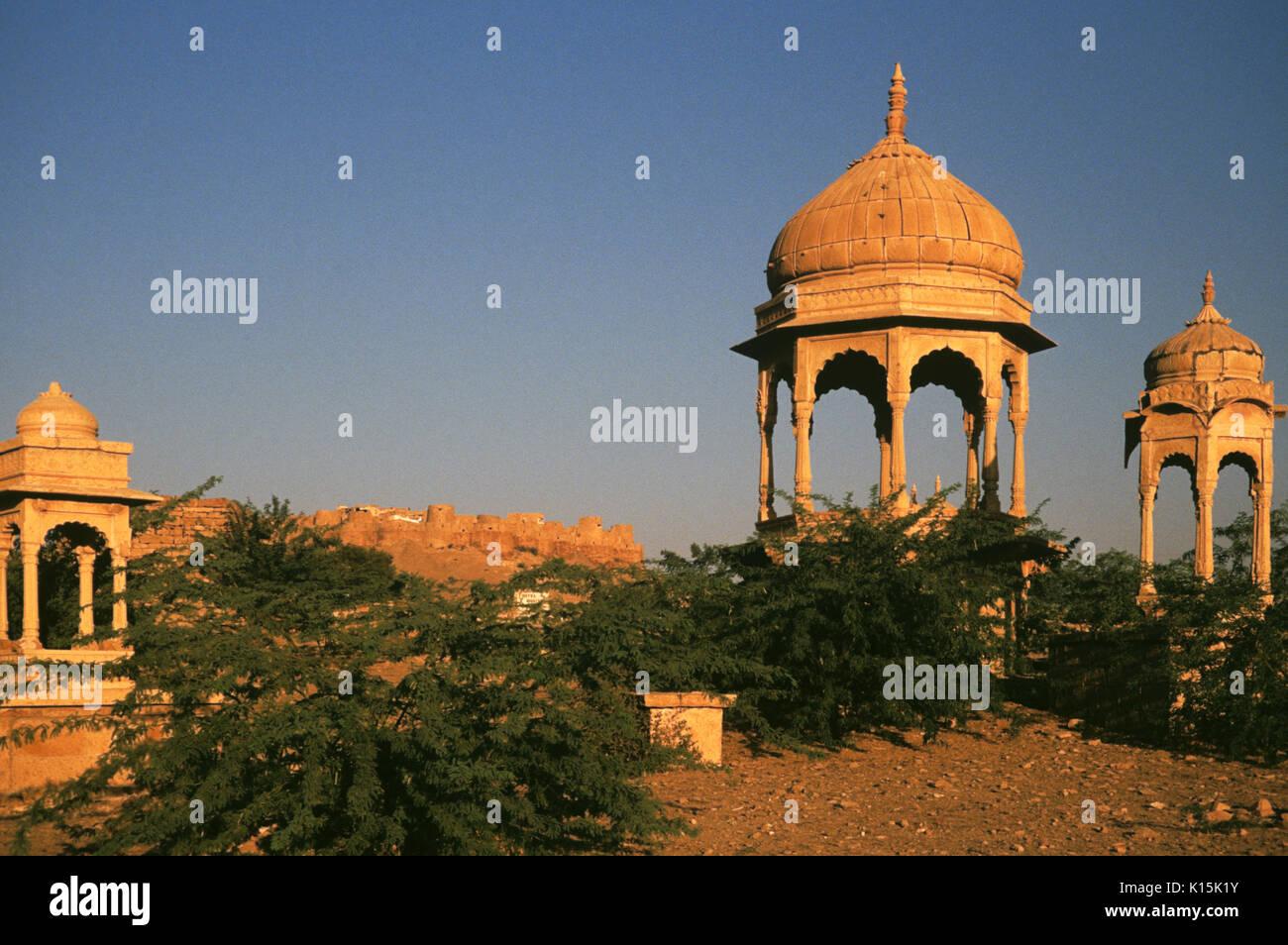 Bada Bagh royal cenotaphs and Jaisalmer Fort, Jaisalmer, Rajasthan, India - Stock Image