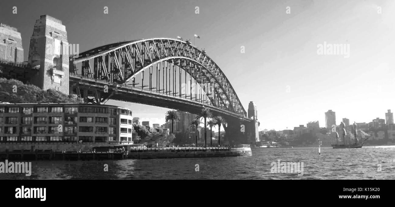 A Three-masted tall ship by Sydney Harbour Bridge, Sydney-B&W. - Stock Image