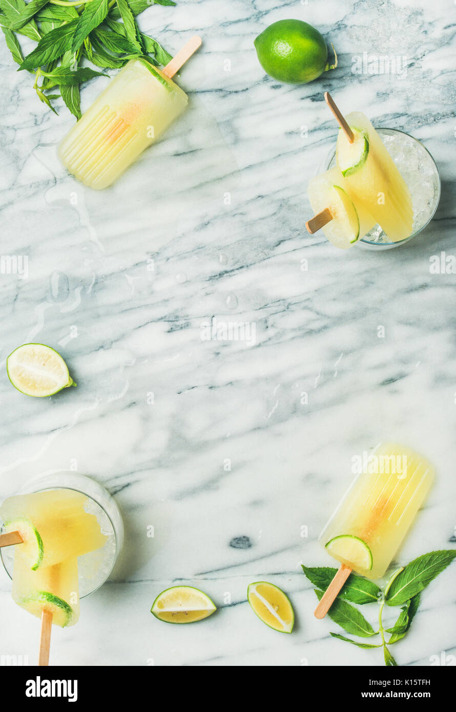 Summer refreshing lemonade popsicles with lime and mint leaves Stock Photo