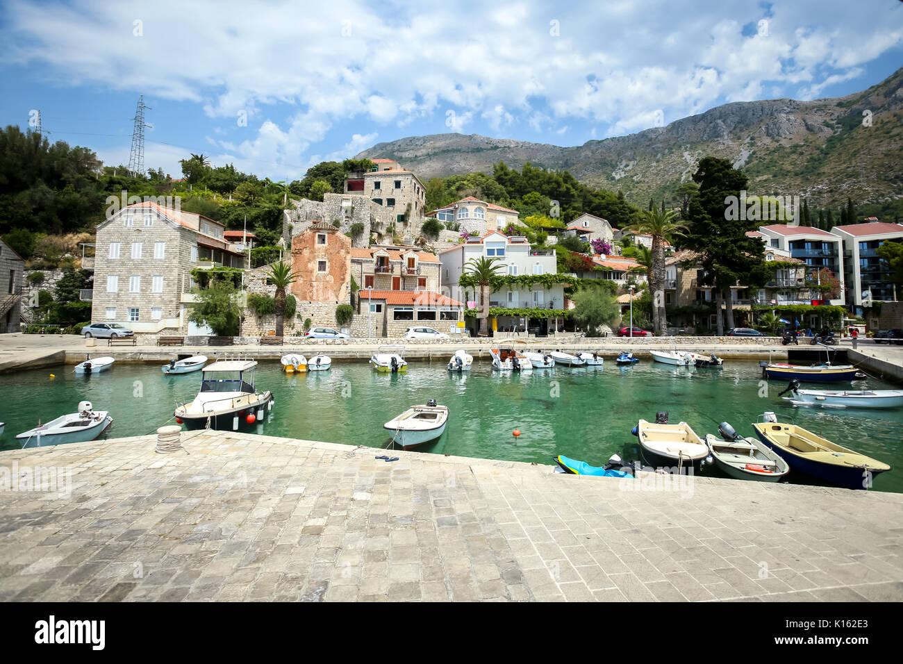 Boats anchored at pier at Dubrovnik riviera in Mlini, Croatia. - Stock Image