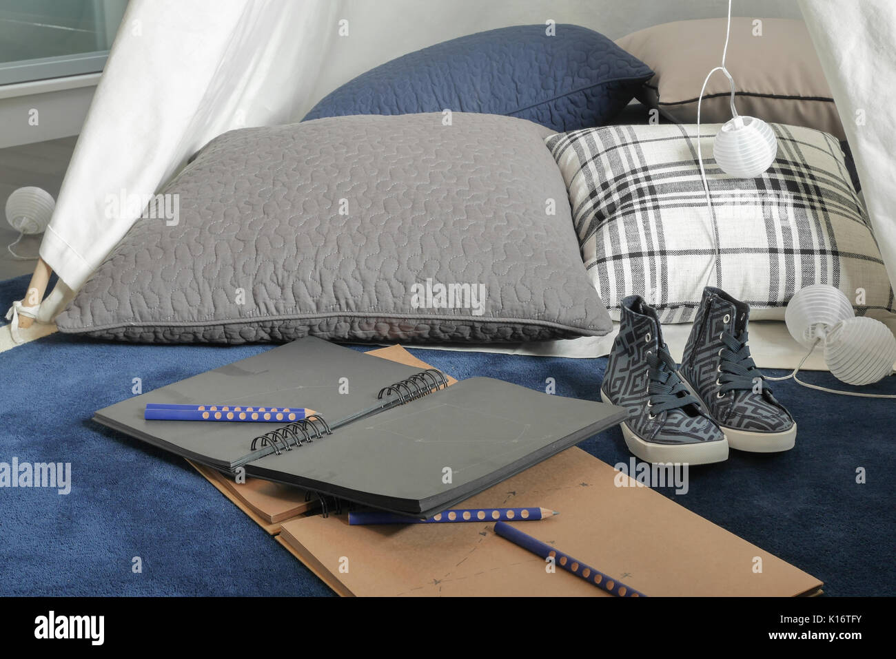 Notebooks and pillow with comfy space for creative people - Stock Image