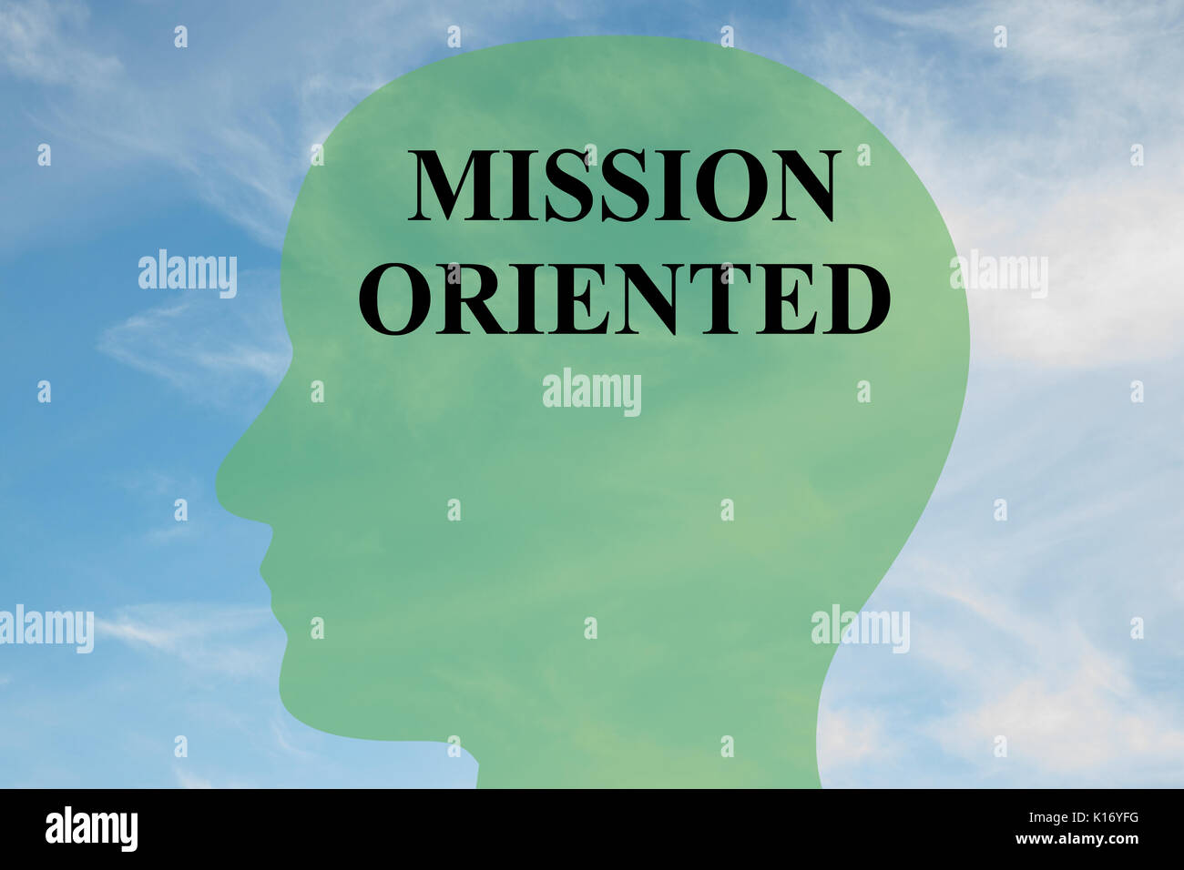 Render illustration of 'MISSION ORIENTED' script on head silhouette, with cloudy sky as a background. - Stock Image