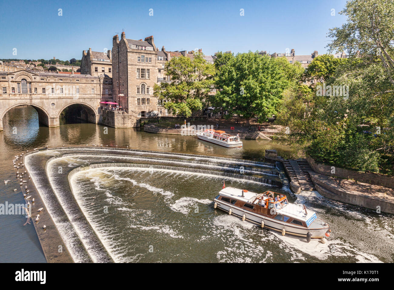 5 July 2017: Bath, Somerset, England, UK - Pleasure Boats at Pulteney Weir on the River Avon. Stock Photo