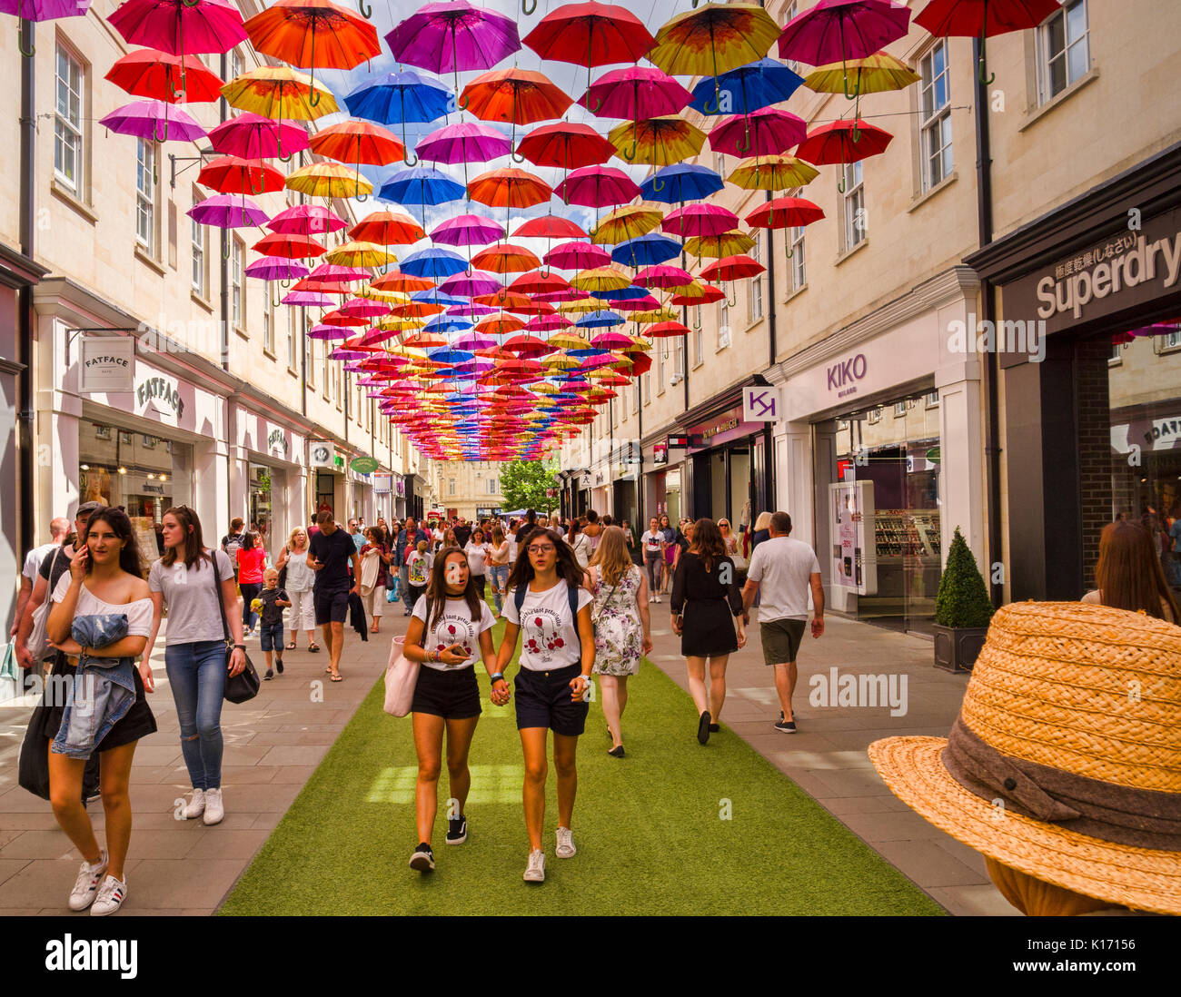 8 July 2017: Bath, Somerset, England, UK - Shopping in the SouthGate shopping centre. Above is the city's installation of 1000 umbrellas. - Stock Image