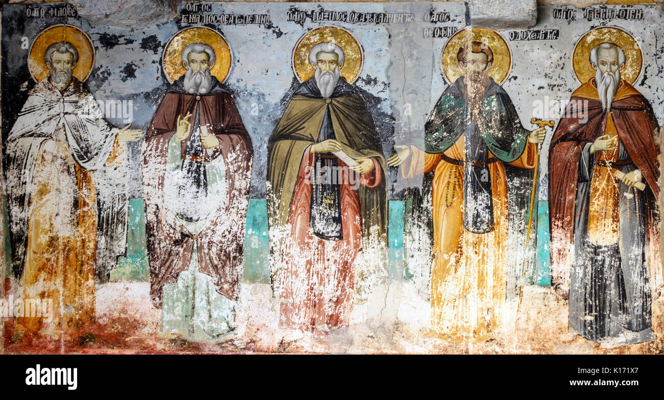 Mount Athos, Greece - March 27, 2017: Timeworn frescoes of saints on the outer side of the Church of Protaton in karyes, Mount Athos - Stock Image