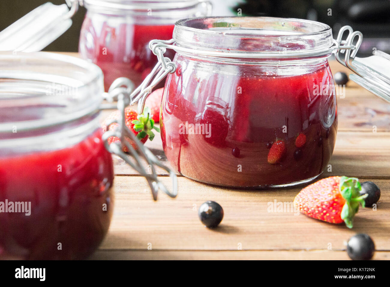 Homemade jam with berries on the wooden table - Stock Image