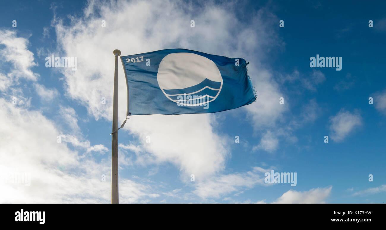 Beach Flag at ISLE OF ANGLESEY, GWYNEDD, NORTH WALES - - Stock Image