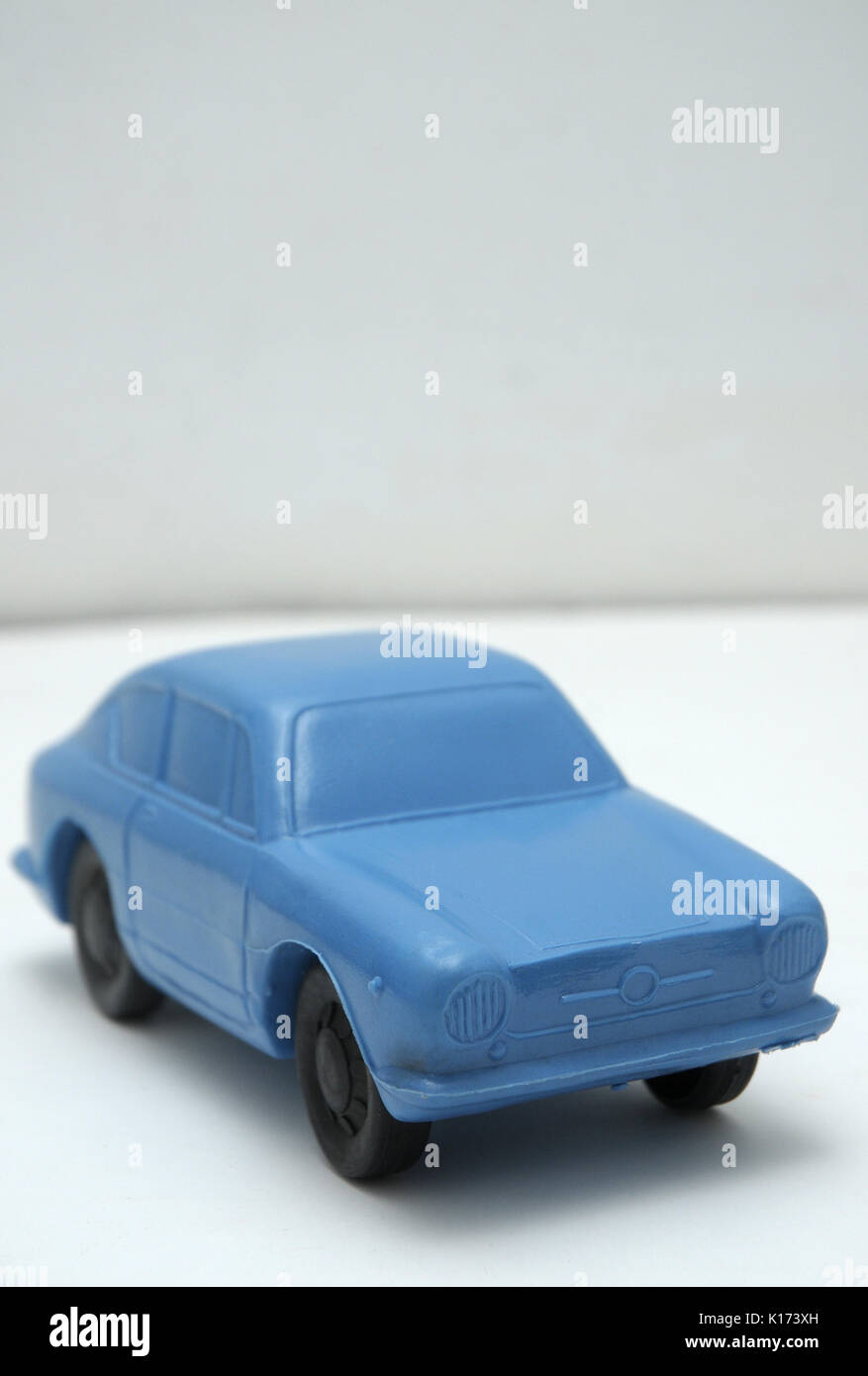 BLUE CAR MADE ON PLASTIC Synthetic material, obtained by carbon polymerization, which can be molded by pressure or heat - Stock Image