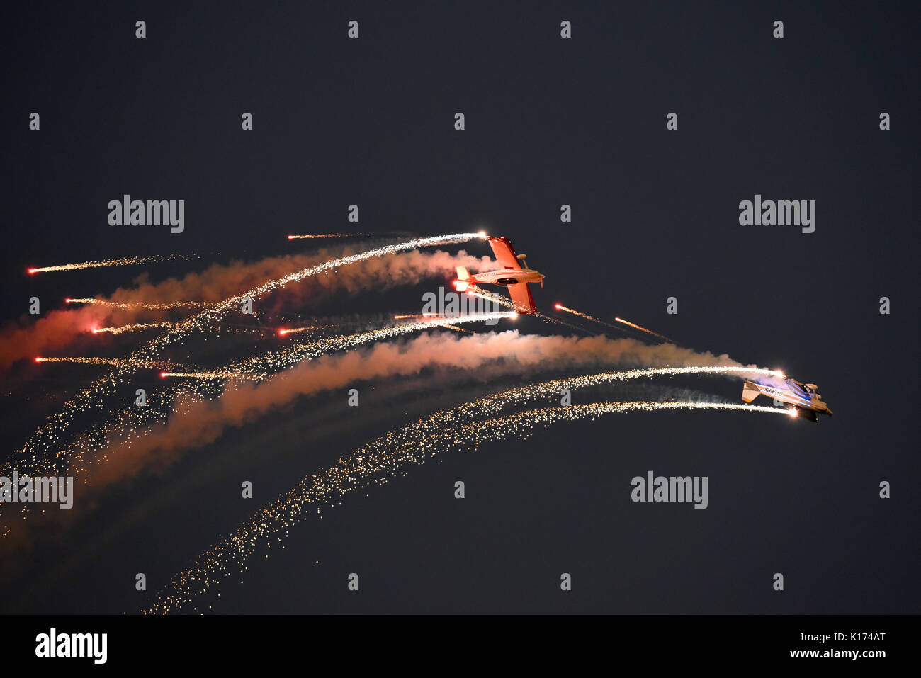 Fireflies aerobatic display team flying their pyrotechnics show at the Clacton airshow at dusk. Space for copy - Stock Image