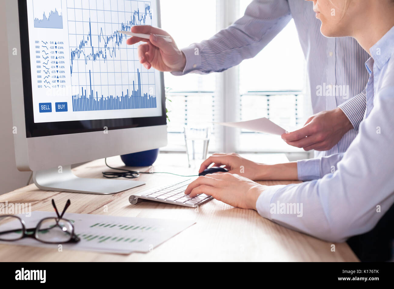 Team of traders working with forex (foreign exchange) trading charts and graphs on computer screen, concept about stock market investment, finance, se - Stock Image