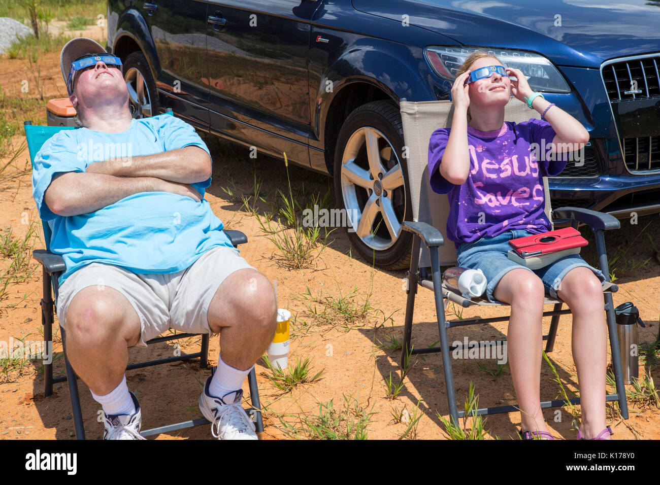 Observers wearing eclipse glasses watch the Great American Eclipse on August 21, 2017. - Stock Image