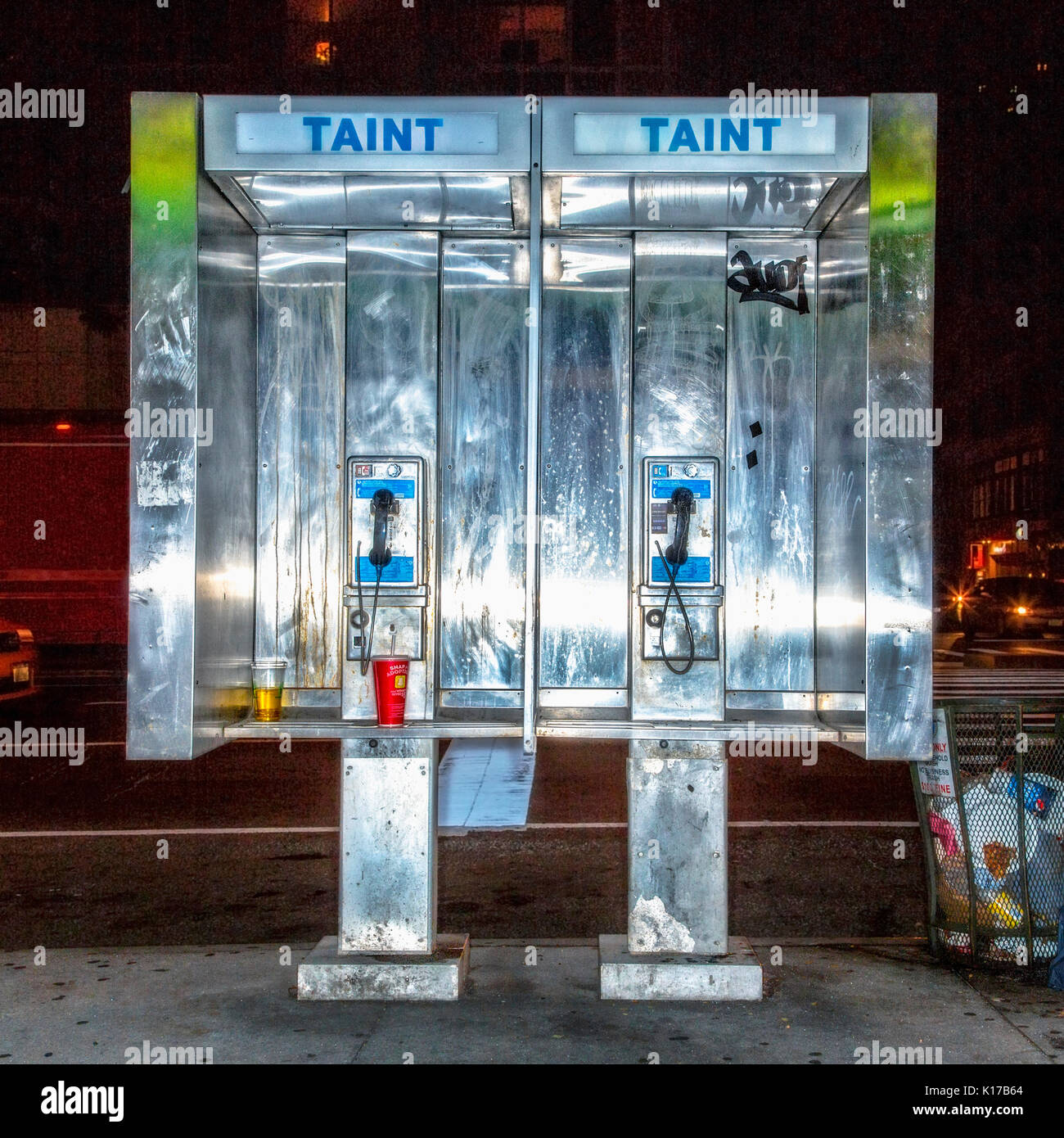 Telephone booths at night - Stock Image