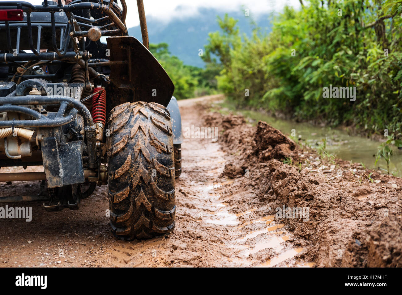 Traveling activity, Off road buggy on country road in rainy day - Stock Image