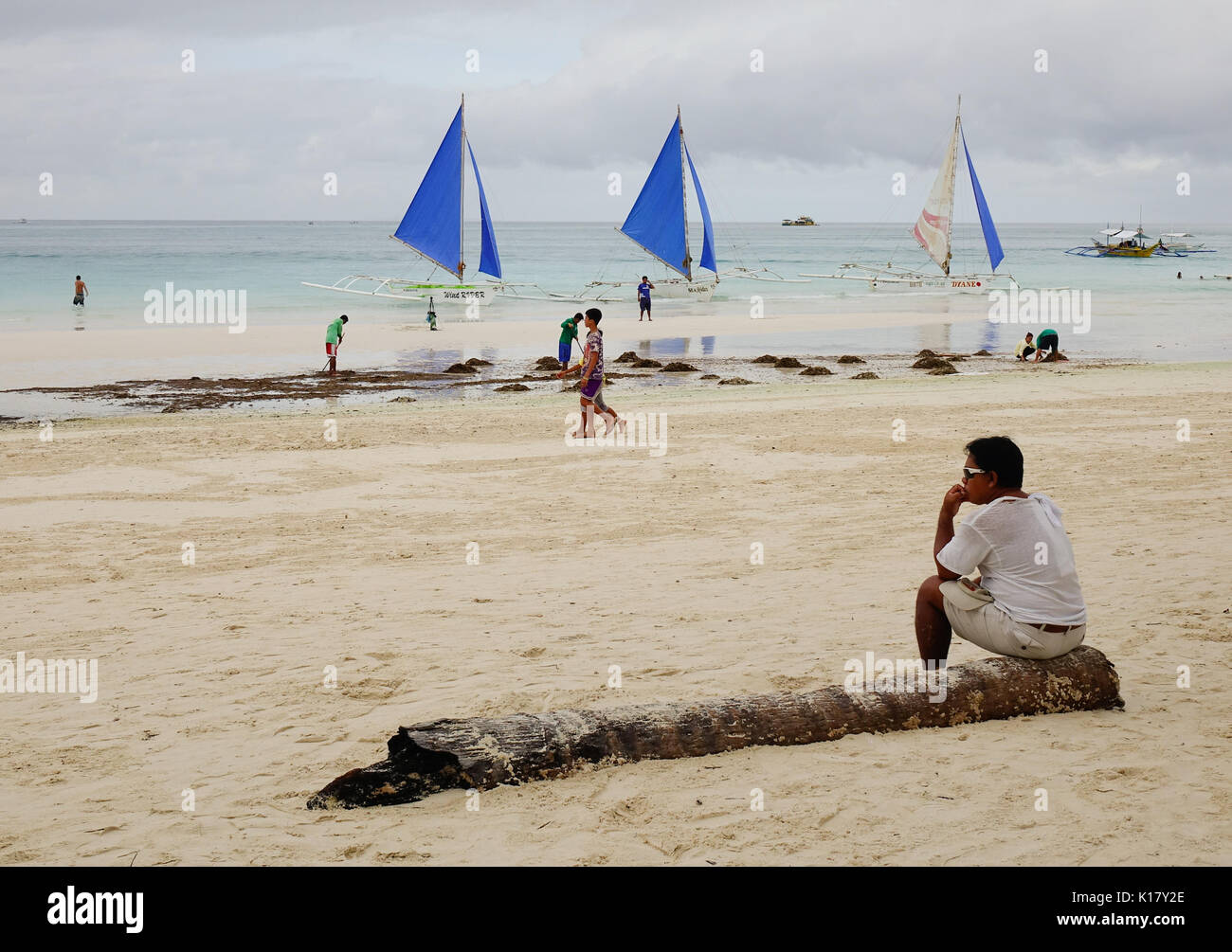 Kalibo, Philippines - Dec 17, 2015. People on the beach in Boracay island, Philippines. Boracay Island and its beaches have received awards from numer - Stock Image