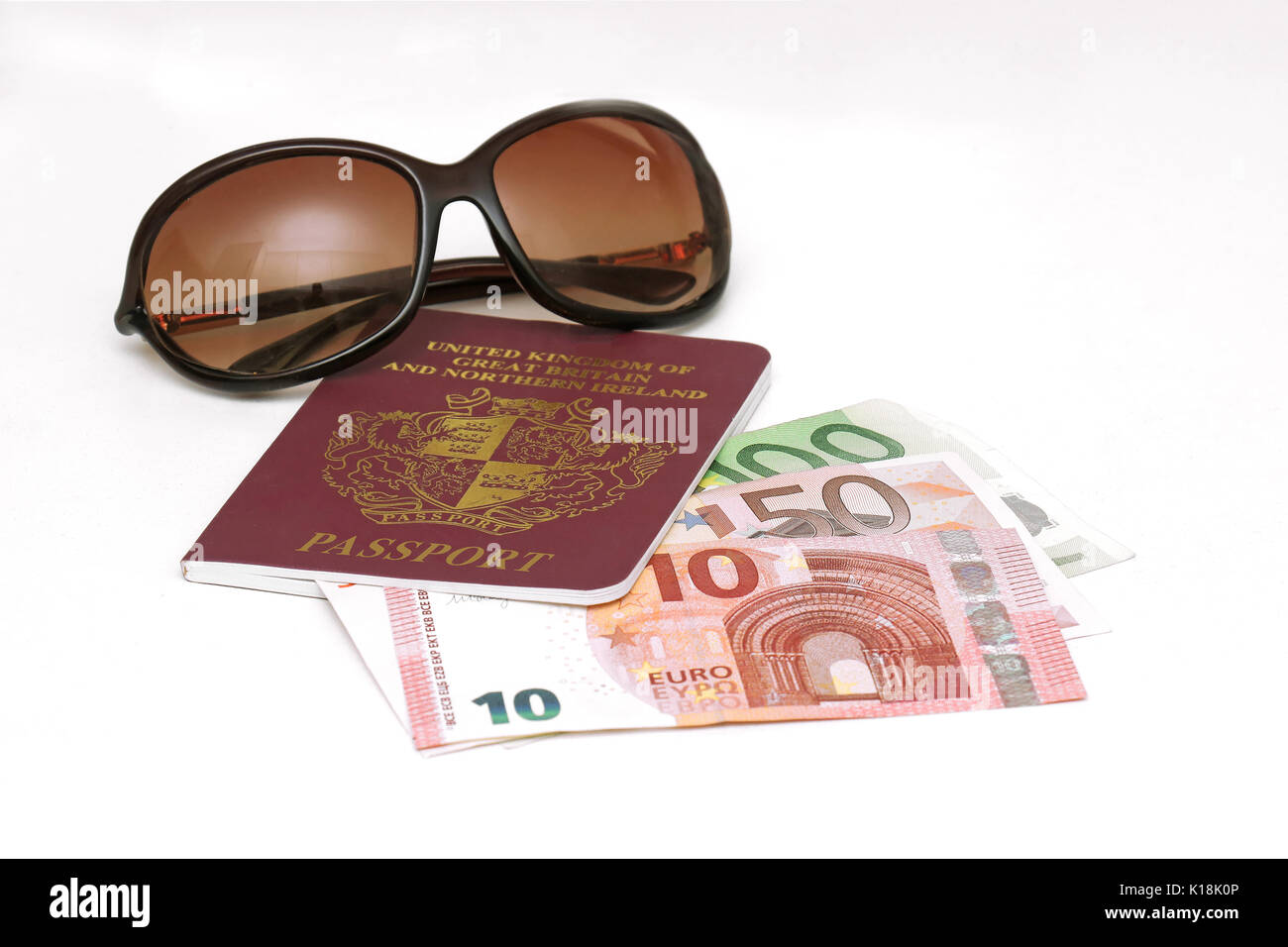 British passport with European money and sunglasses ready for summer vacation abroad - Stock Image