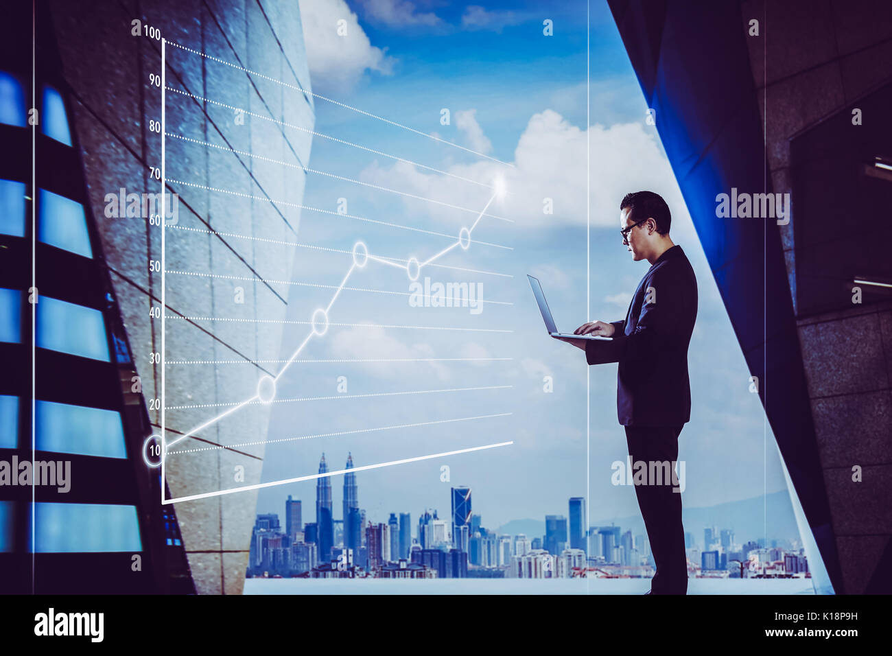 Businessman using laptop with graph statistical analysis ,Business success concept. - Stock Image