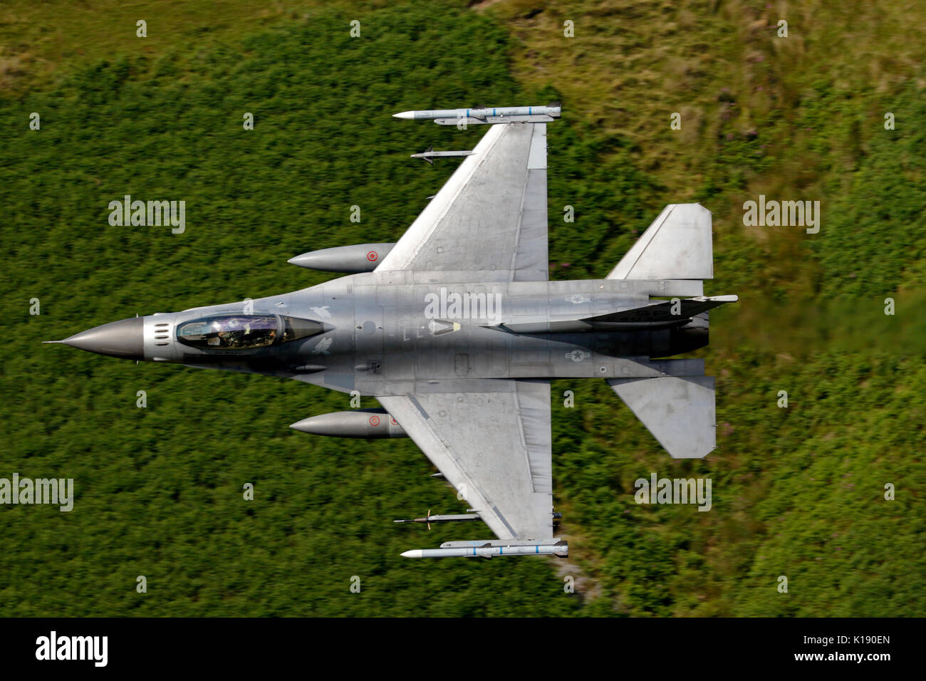 General Dynamics F-16C Fighting Falcon, 480th FS, 52nd FW, USAF based at Spangdahlem in Germany, conducting Low-level flight training in LFA7 Wales - Stock Image
