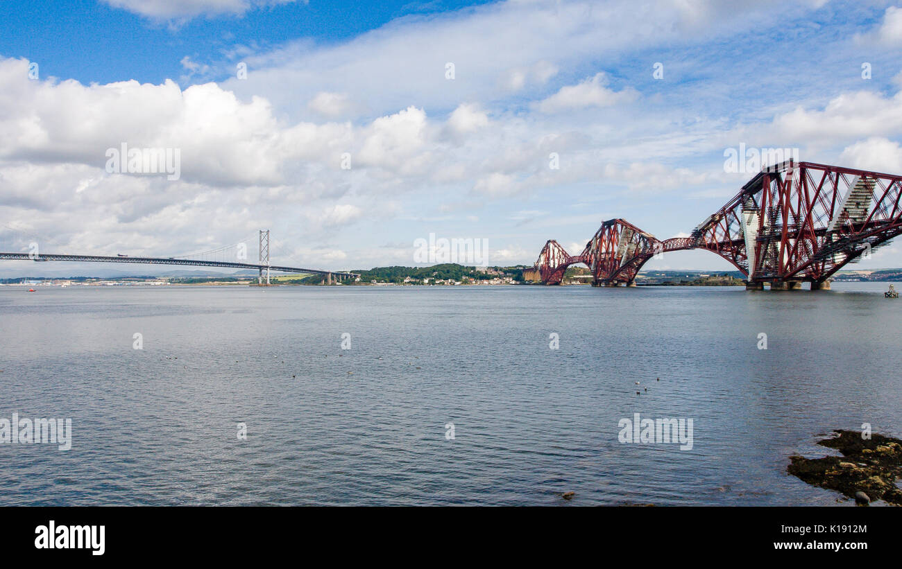 The Forth Rail Cantilever Bridge running across the Firth of Forth is an iconic structure connecting North and South Queensferry Edinburgh Scotland - Stock Image