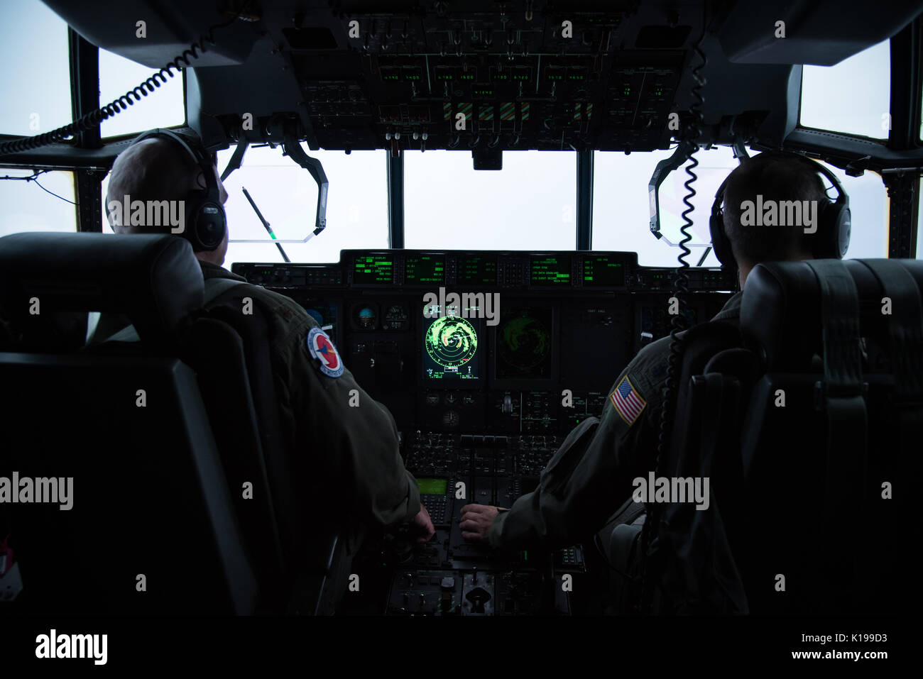 U.S. Air Force Maj. Kendall Dunn and Lt. Col. Ivan Deroche of the the 403rd Wing Hurricane Hunters, pilot a WC-130J Stock Photo