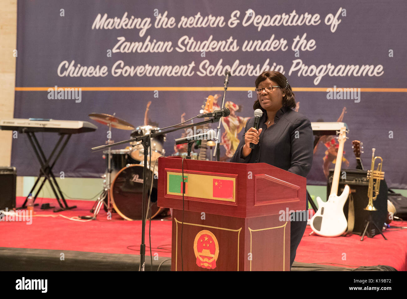 (170826) -- LUSAKA, Aug. 26, 2017 (Xinhua) -- Zambia's Acting Minister of Higher Education Sylvia Chalikosa  speaks during the ceremony at the National Museum in Lusaka, Zambia, Aug. 25, 2017. The Chinese Embassy in Zambia on Friday held a grand ceremony to welcome back as well as bid farewell to students who have received scholarships to study in China. (Xinhua/Peng Lijun) (srb) - Stock Image