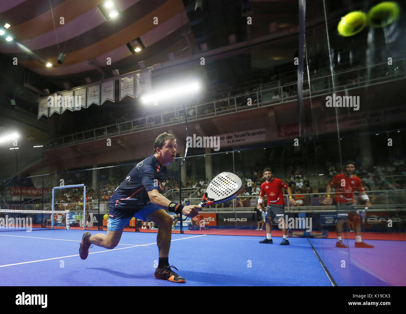 Padel players Francisco Navarro (L) and Daniel Gutierrez 'Sanyo' in action during the Alicante Open 2017 men's semifinal, the sixth event of the professional circuit World Padel Tour, in Alicante, Spain, 26 August 2017. EFE/Manuel Lorenzo - Stock Image