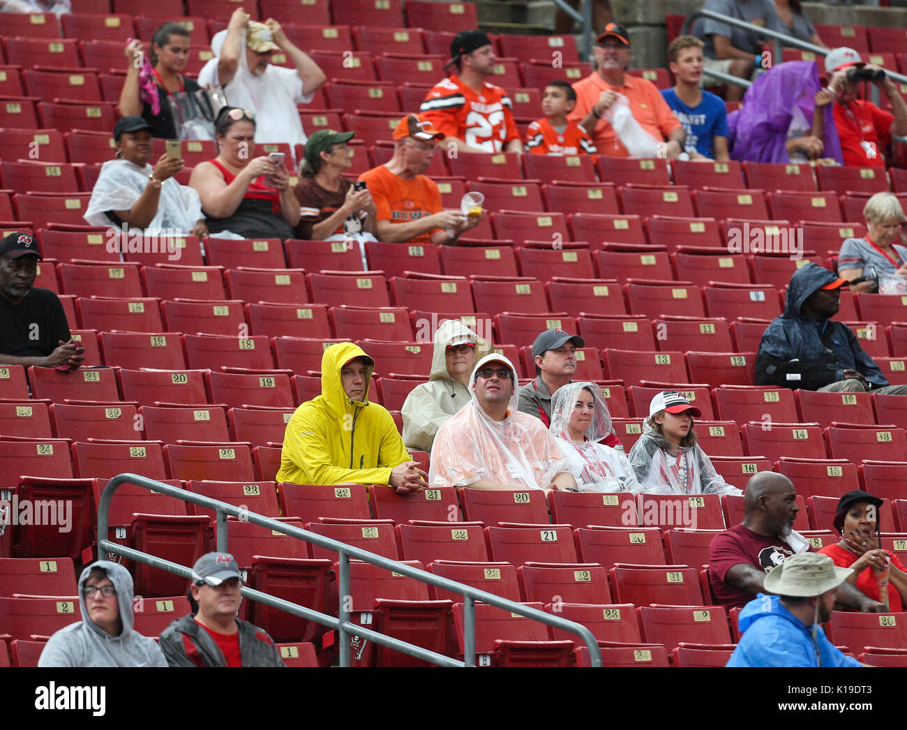 Tampa, Florida, USA. 26th Aug, 2017. MONICA HERNDON | Times.Fans sit in ponchos in the rain before the start of the Tampa Bay Buccaneers preseason game against the Cleveland Browns, at Raymond James Stadium in Tampa, Fla. Credit: Monica Herndon/Tampa Bay Times/ZUMA Wire/Alamy Live News - Stock Image