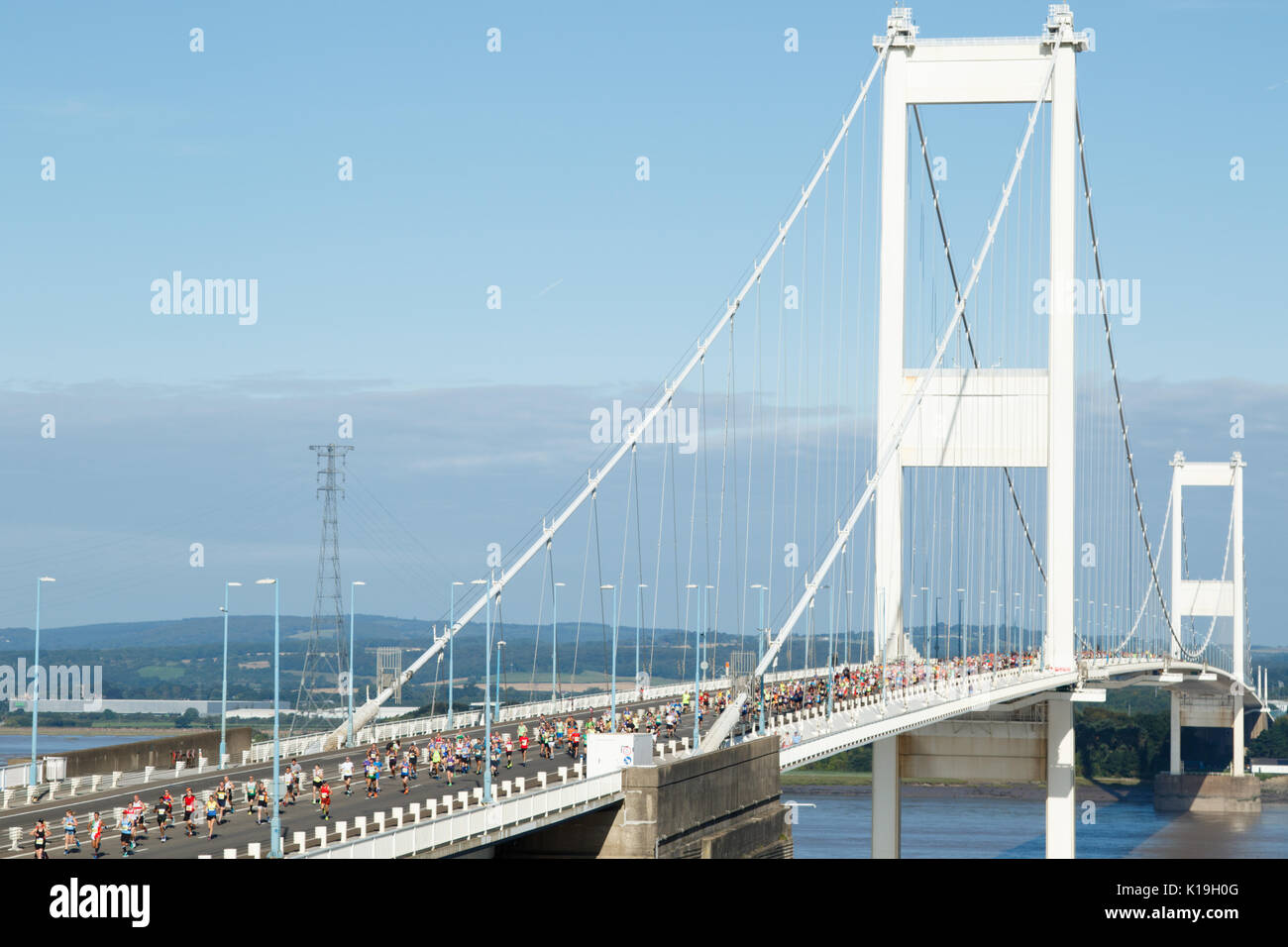 Severn Bridge Half Marathon, South Glouceshire, UK.  27 August 2017.  UK weather:  About 2500 runners take part in the annual Severn Bridge Half Marathon in gorgeous sunshine this morning on the M48, starting and ending on the Welsh side.  The event started at 9:00am with a seperate 10k run at 9:45 am, with many running for charity.  Credit: Andrew Bartlett/Alamy Live News - Stock Image