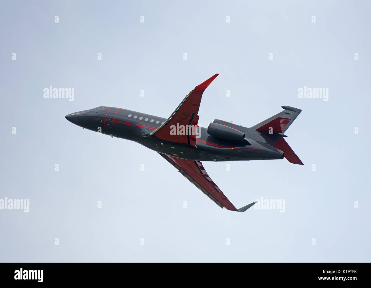 French Built Dassault 3 engined Business luxury jet aircraft at Invernees airport in the Scottish Highlands. - Stock Image