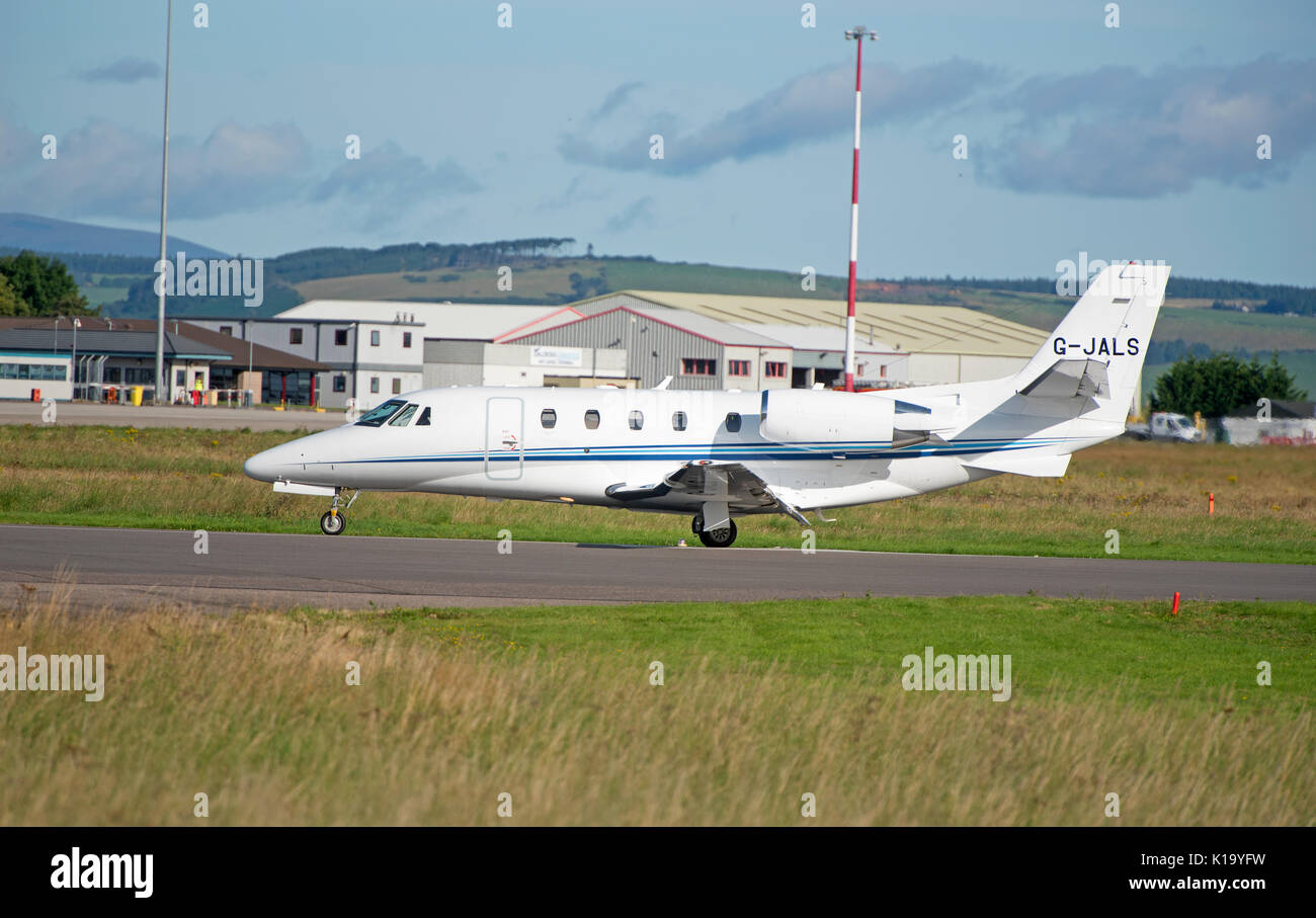 Thin engine Air Charter Cessna 560 arriving at Inverness Dalcross airport Stock Photo