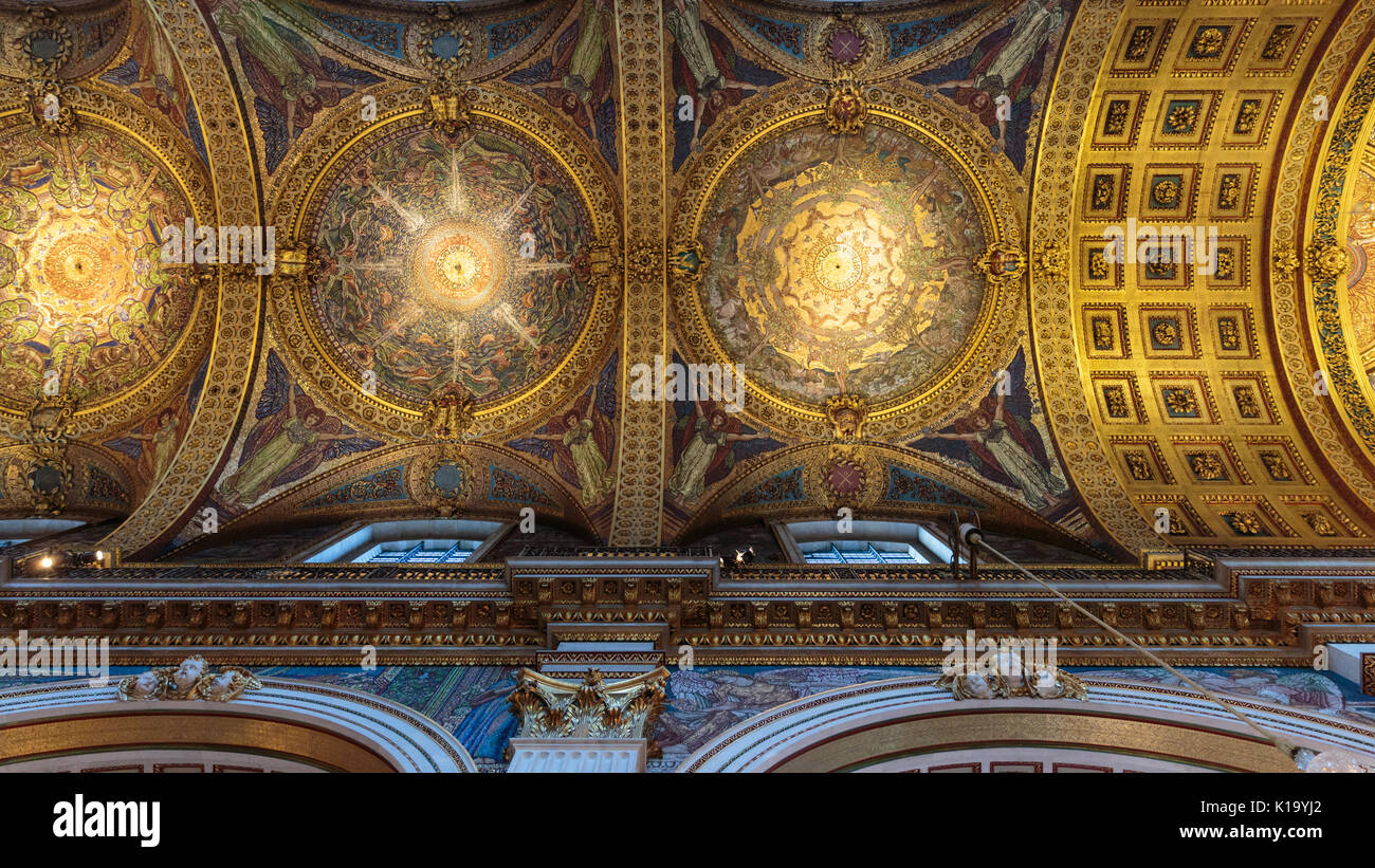 St Paul's Cathedral interior, view up to the ceiling and wall paintings, carvings and gilded decorations of the inner dome, London UK - Stock Image