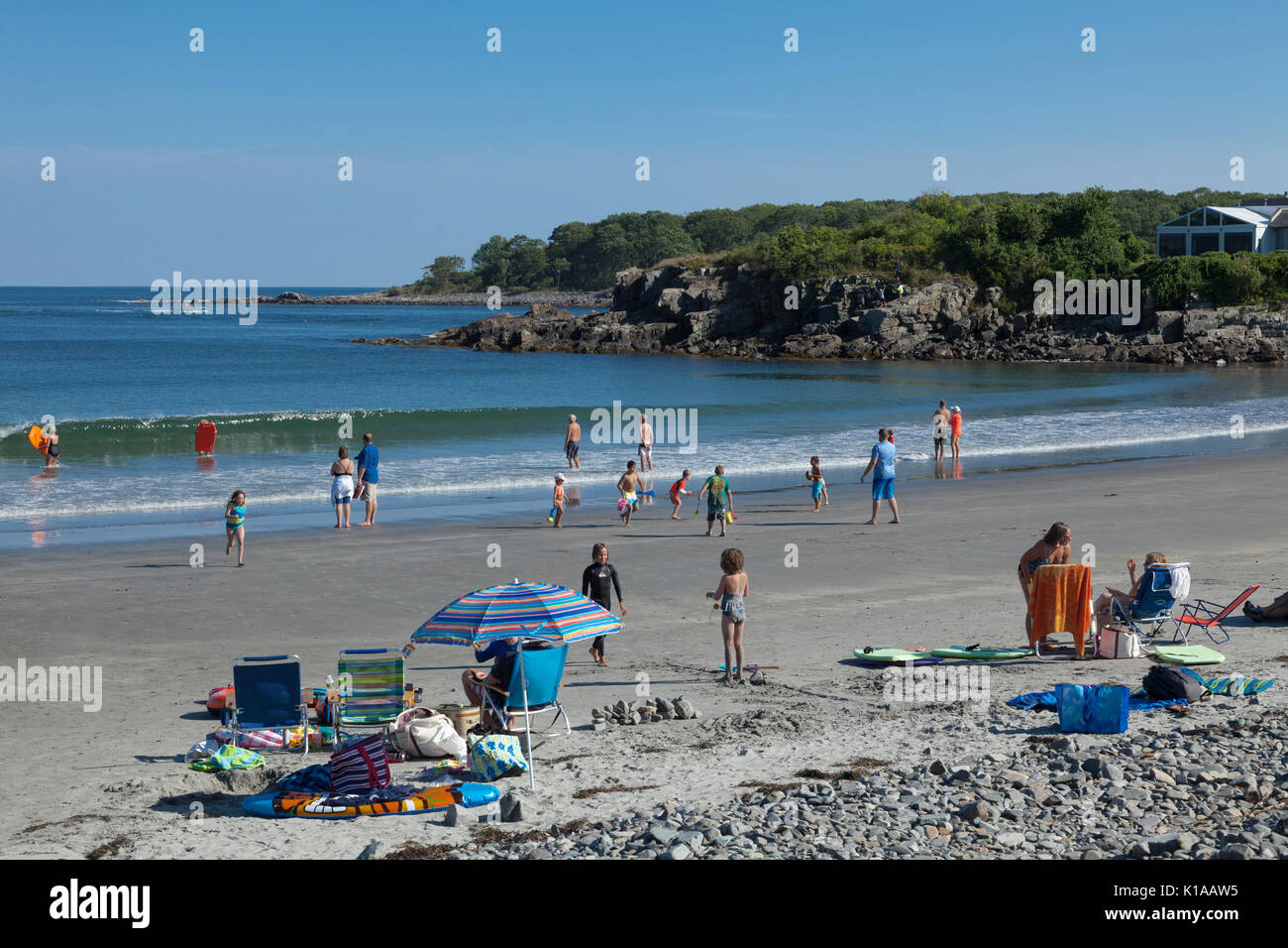 People relaxing at York Harbor Beach, York, Maine - Stock Image