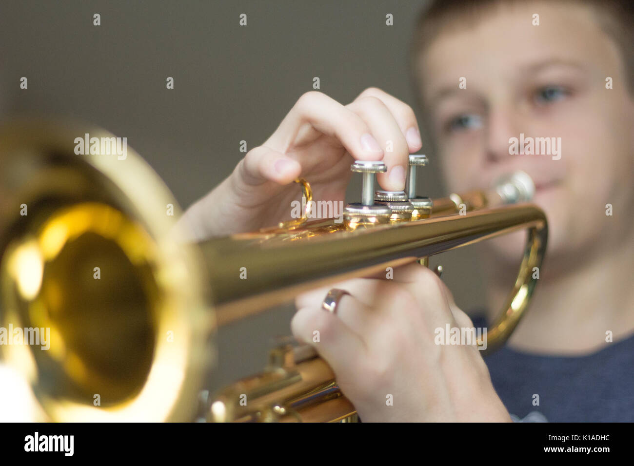 Young Boy Practicing his Trumpet - Stock Image