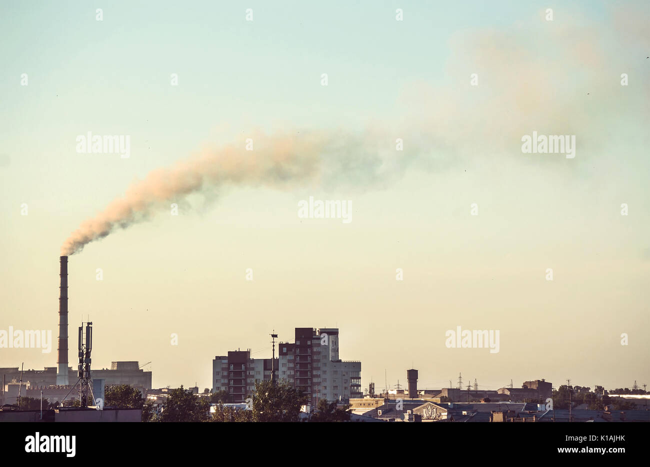Smoke from factory pipes. Air pollution industry - Stock Image